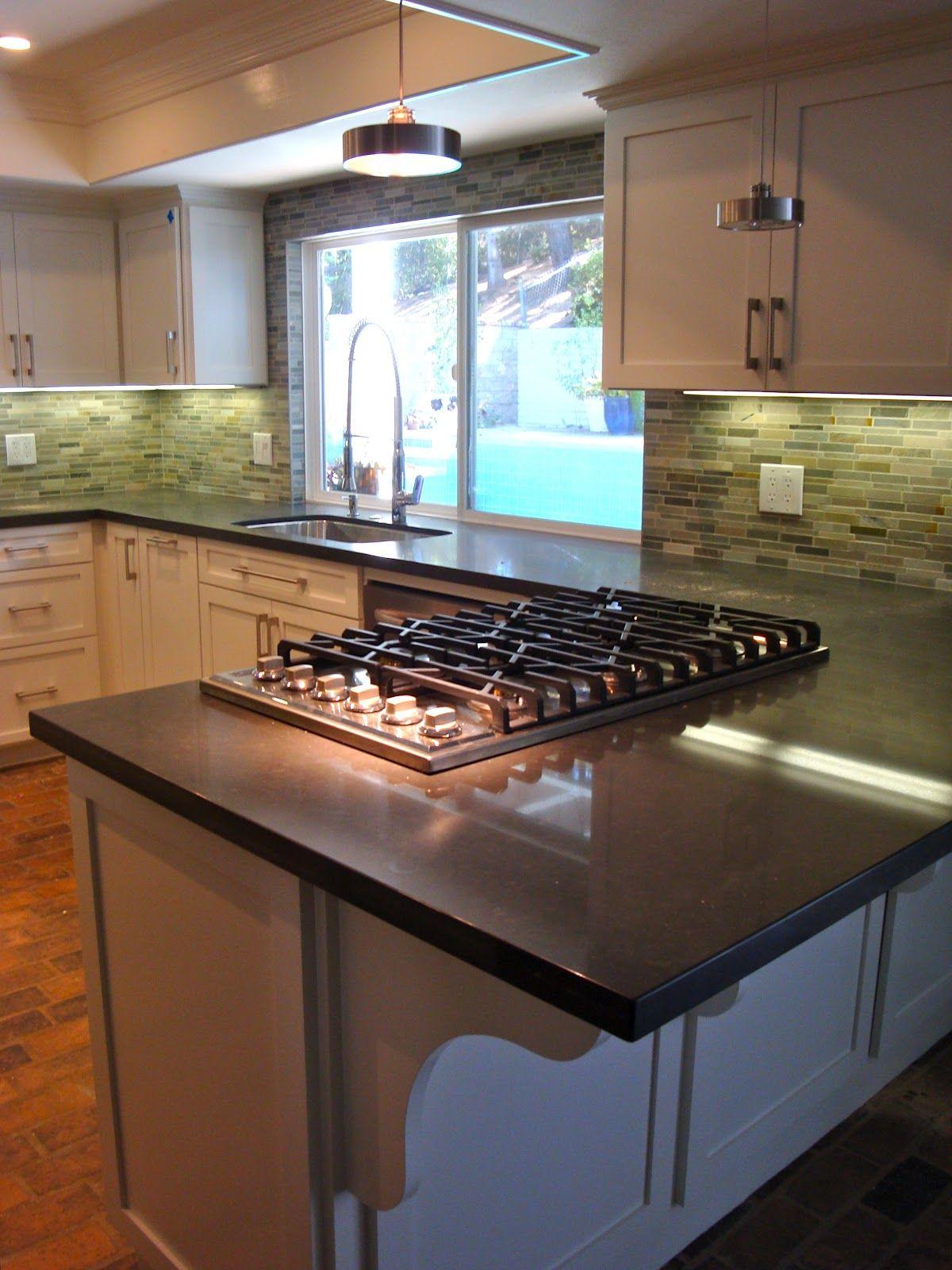 tasty kitchen peninsula with cooktop   sherri cassara