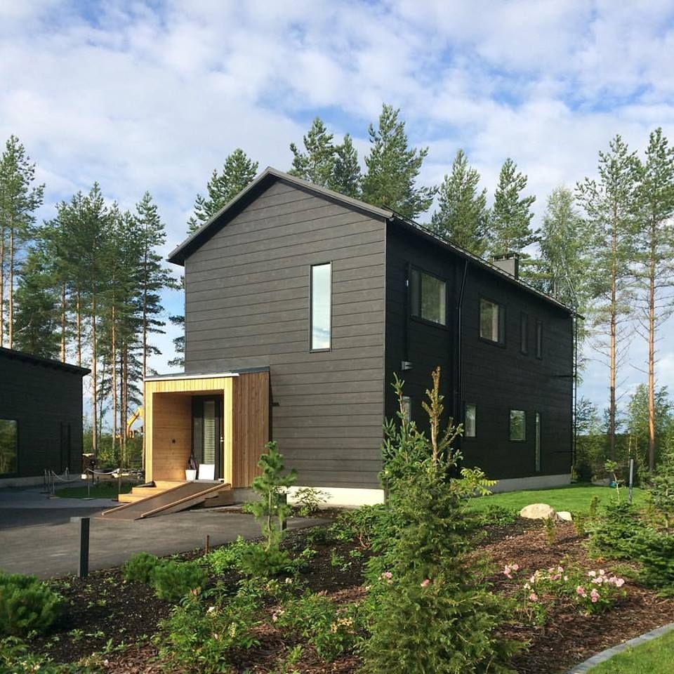 Honka markki scandinavian minimalism honka log homes for Scandinavian style homes exterior