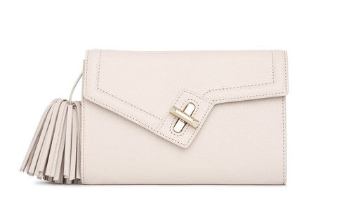 Mini MILCK Clutch Classic in ivory with gold hardware.  Small, but not too tiny, this fulfills all the basic clutch duties. Meanwhile, the chain strap  gives it the versatility to sling crossbody and worn with a bit of edge.