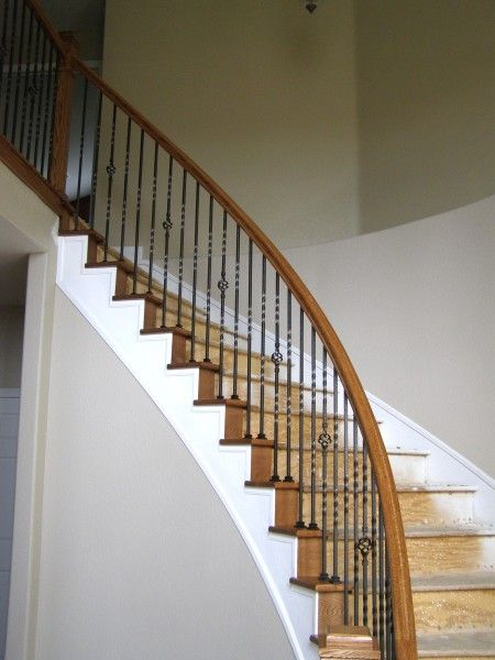 Custom Built Stairs With Iron Railing In Denver Colorado