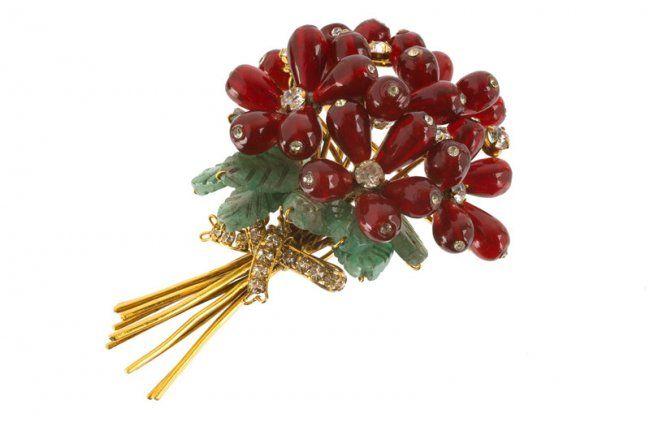 goldtone floral brooch, set with red and green stones and rhinestones. Signed Iradj Moini