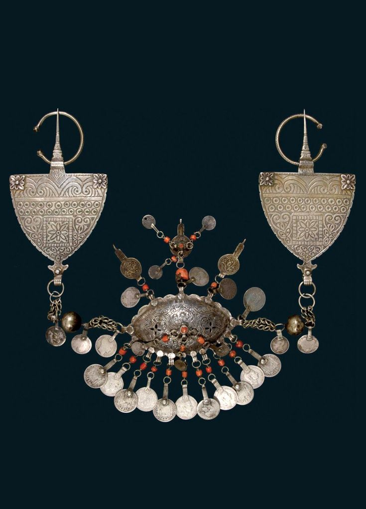 Morocco - Nador region | Pair of fibula; silver, gilt silver, coral beads and silver coins dating from 1880 to 1885. Weight: 858 gr | ca. 1890 | 2 268€ ~ sold (Dec '11)