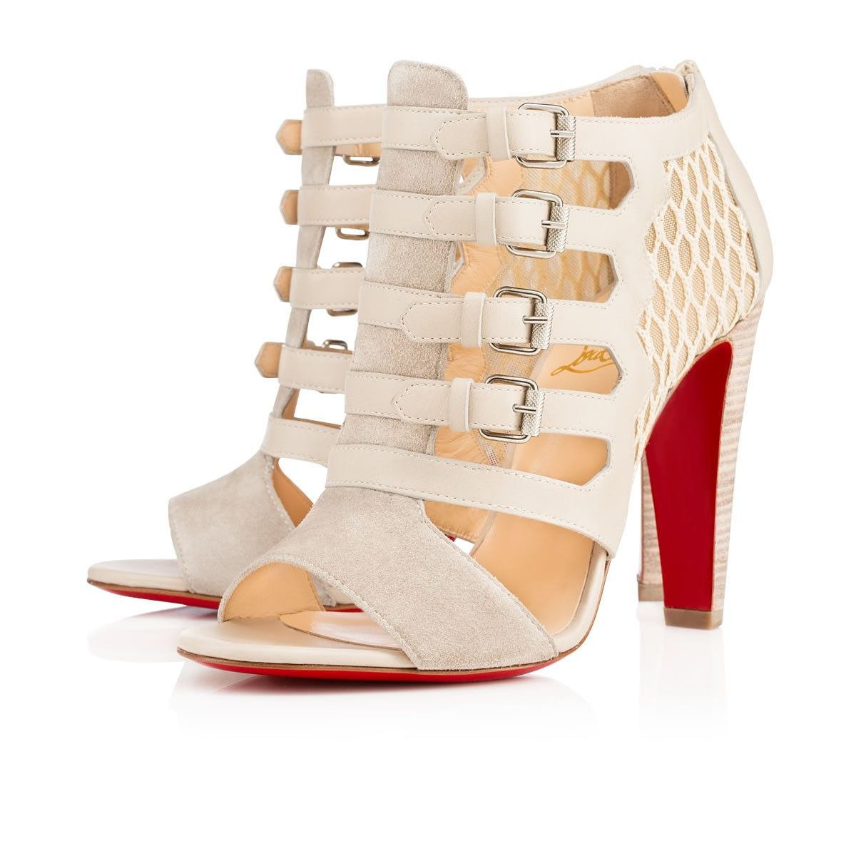 """""""Trotti"""" is an extraordinary 100mm sandal of mixed materials and influences.  Its upper is dressed in alluring colombe fishnet, calf leather and suede and finished with four gladiator straps with silver striated buckles.  Zip into this strong silhouette for a formidable look, daytime or evening."""