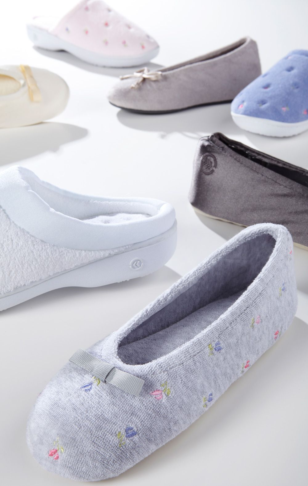 Step into immediate comfort and effortless style. Isotoner slippers are constructed with durable fabrics and classic silhouettes that you'll look forward to wearing. Styles include our newest technologies for lasting comfort. #KeepersofHandsandFeet