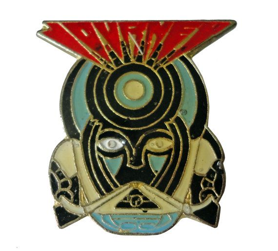 """vintage JOURNEY Frontiers metal enamel pin button Faithfully 1980s rock concert by VintageTrafficUSA  14.00 USD  A vintage JOURNEY pin! This pin looks like its blinking! Decent condition but with enamel missing on one eye. Measures: approx 1"""" 20 years old hard to find vintage high-quality cloisonne lapel/pin. Beautiful die struck metal pin with colored glass enamel filling. Add inspiration to your handbag tie jacket backpack hat or wall. Have some individuality = some flair…"""