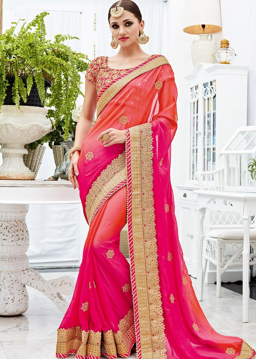 4793010d004f78 Two tone shaded #silk #chiffon #saree with heavy embroidered borders  throughout. Accompanied by a designer pink art silk blouse in all over  mirror work.