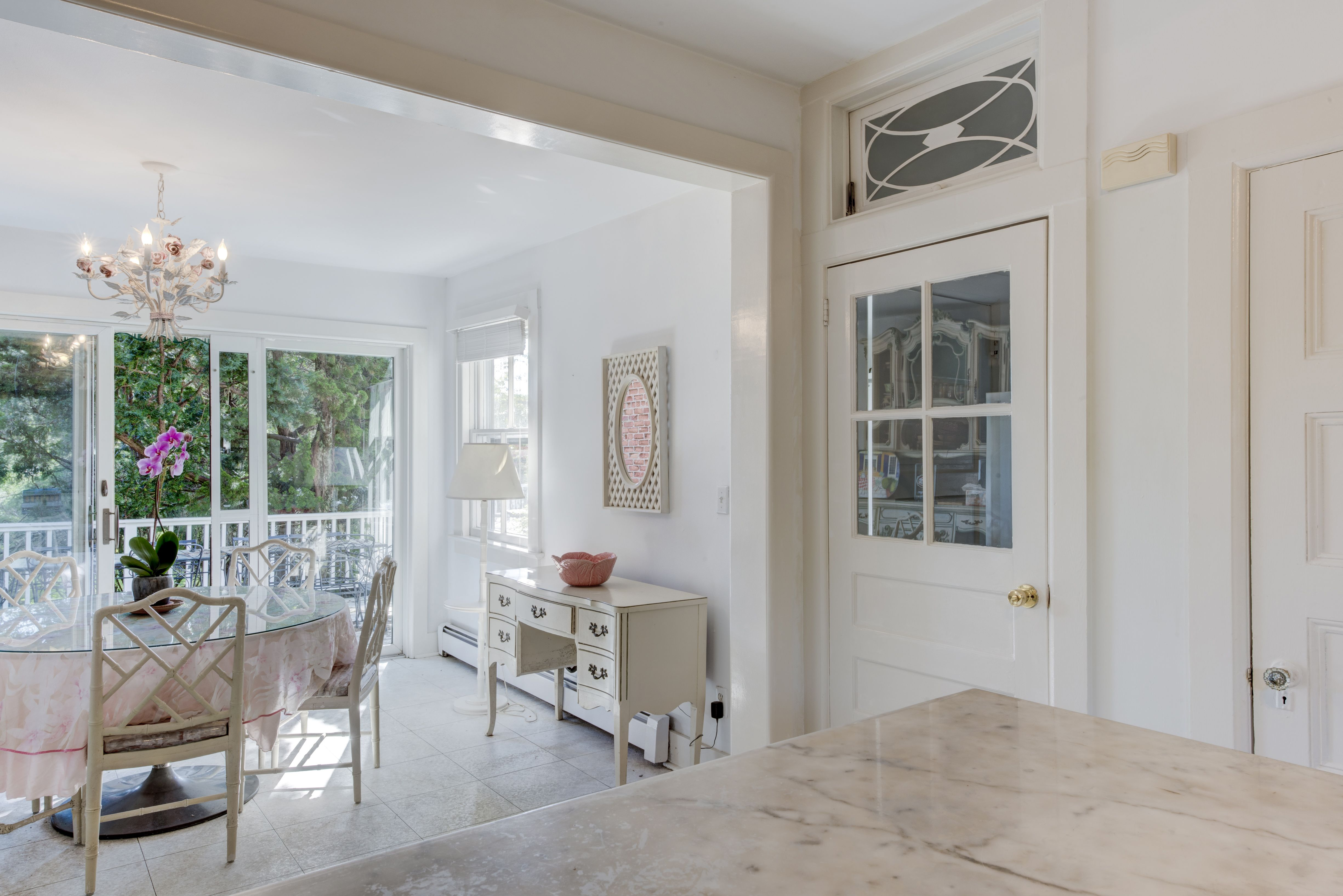 Love it! The eat-in kitchen of this Westhampton estate leads out to ...