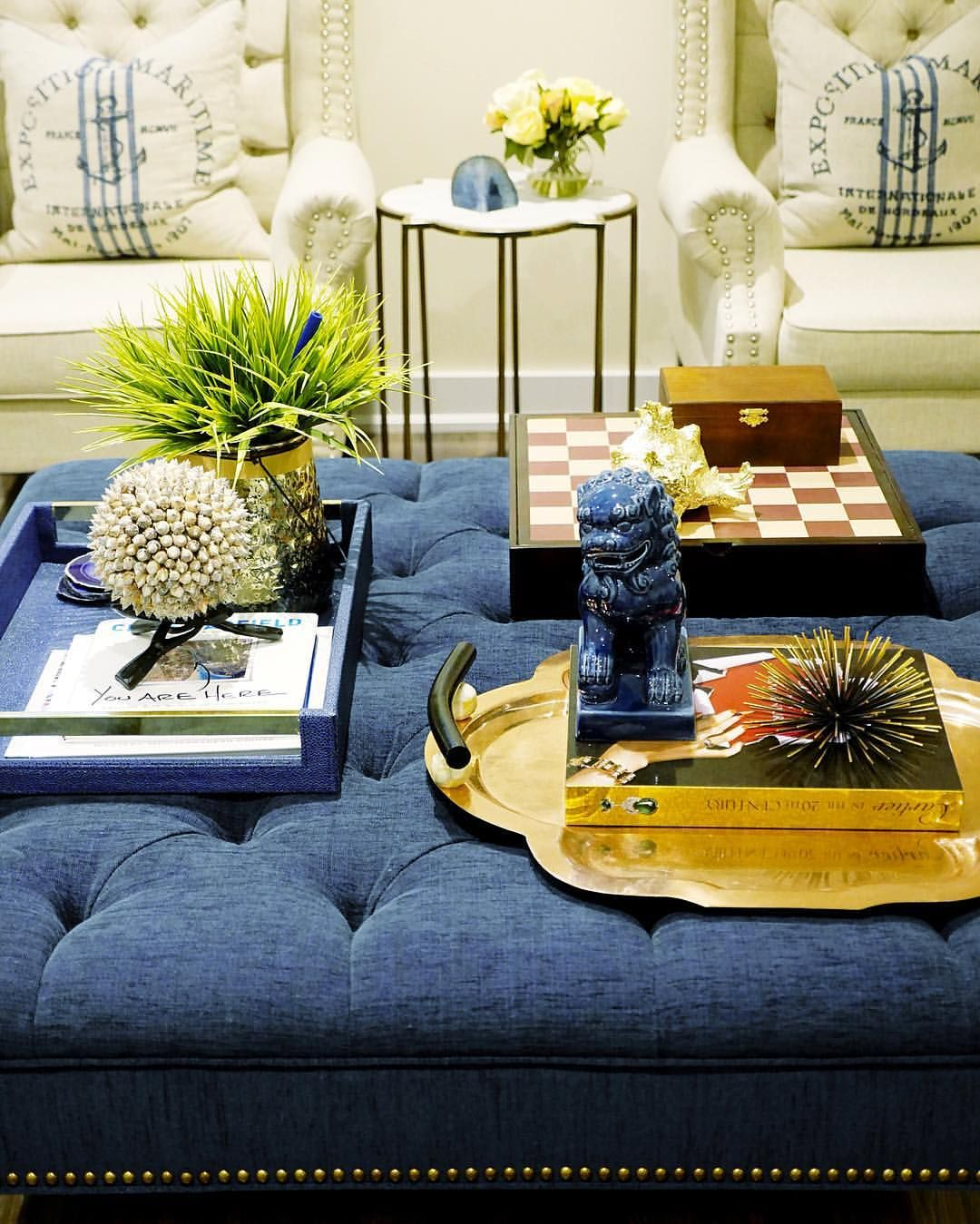 family room decor | tufted navy ottoman | coffee table styling