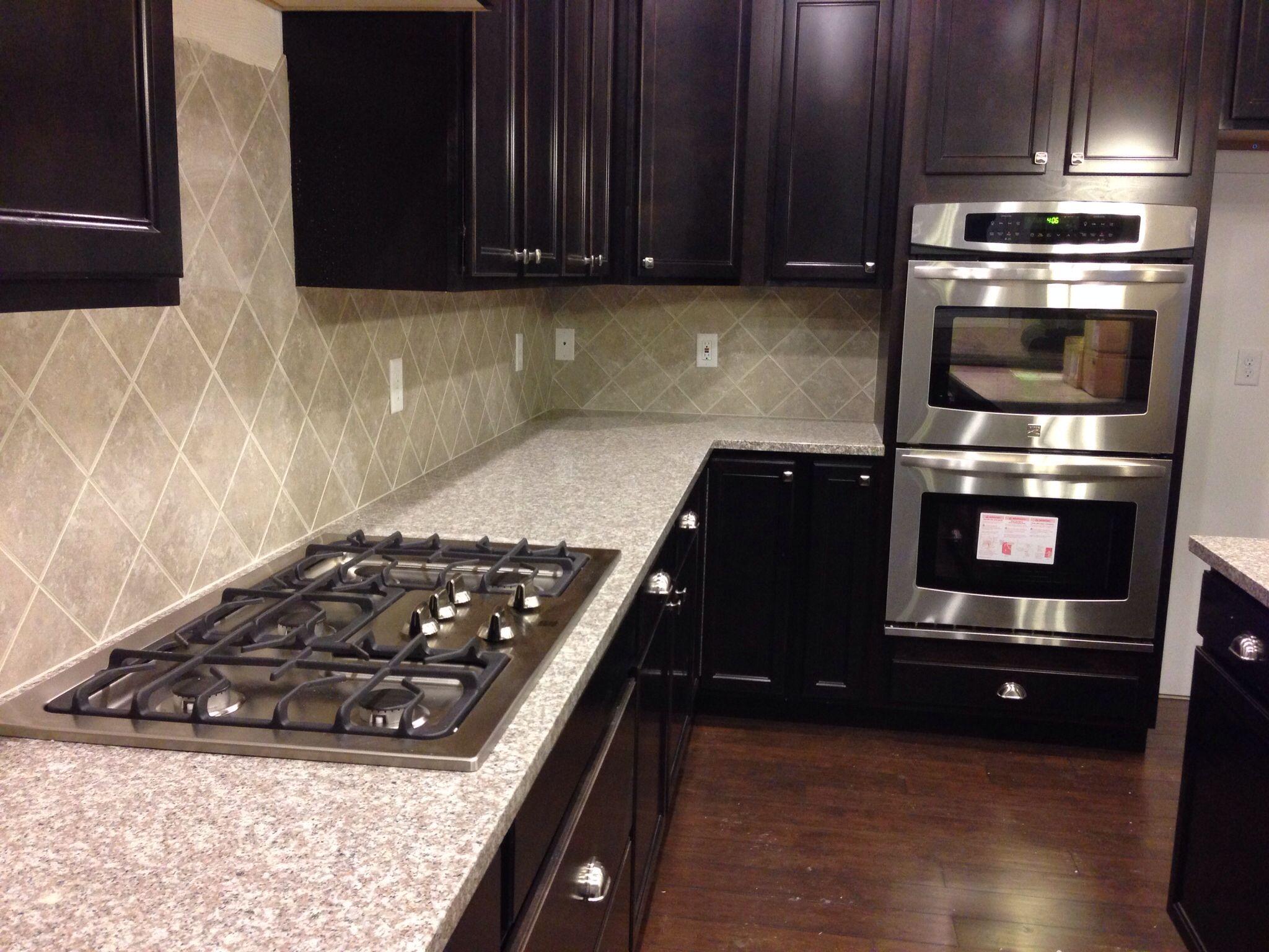 mahogany granite countertops with eased edges sandalo tile on the mahogany granite countertops with eased edges sandalo tile on the diagonal and kenmore double backsplash ideaskitchen