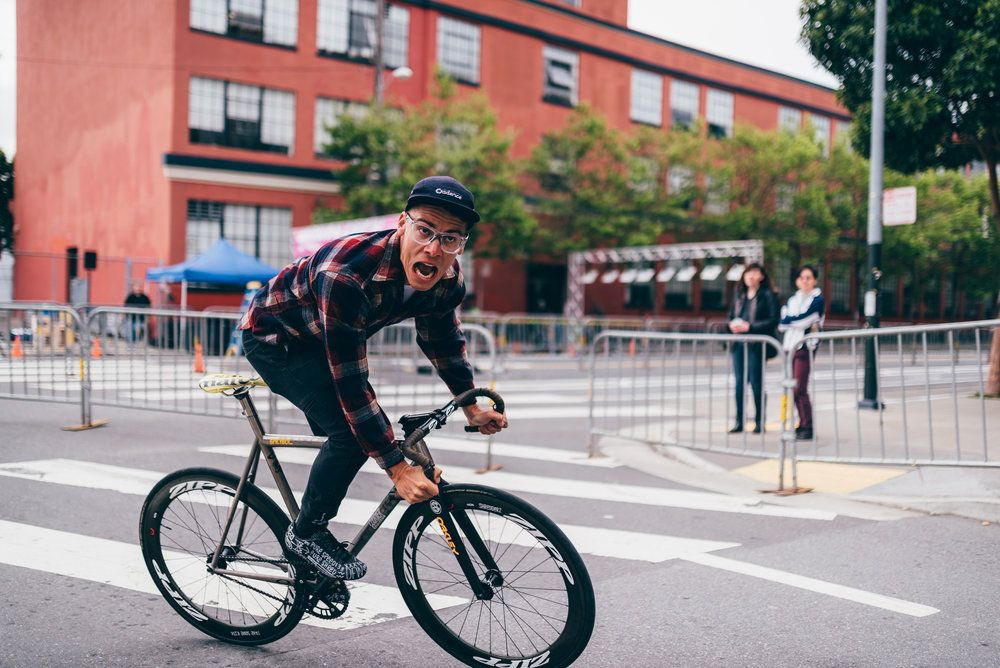 Chas Christiansen Cycling In Action Through The Streets 1 000 668
