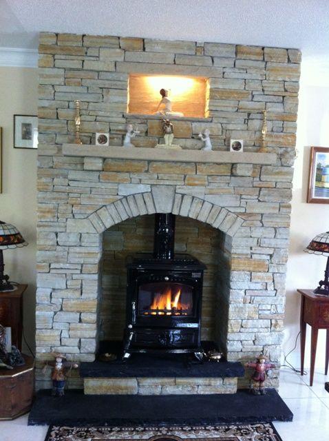 Gold Silver Donegal Quartzite Natural Stone With A Black Limestone Hearth Www Mcmonaglestone Com Brick Hearth Natural Stone Fireplaces Hearth