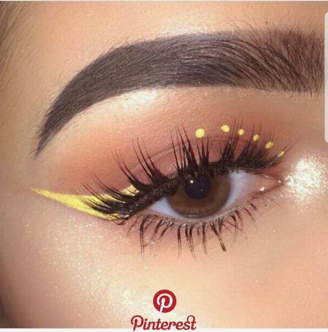 Yellow winged eyeliner makeup #eye #eyeliner #eyemakeup #Makeup #yellow #makeupgoals