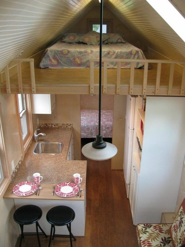 It looks like there is a bedroom on the ground level too for 4 bedroom tiny house on wheels