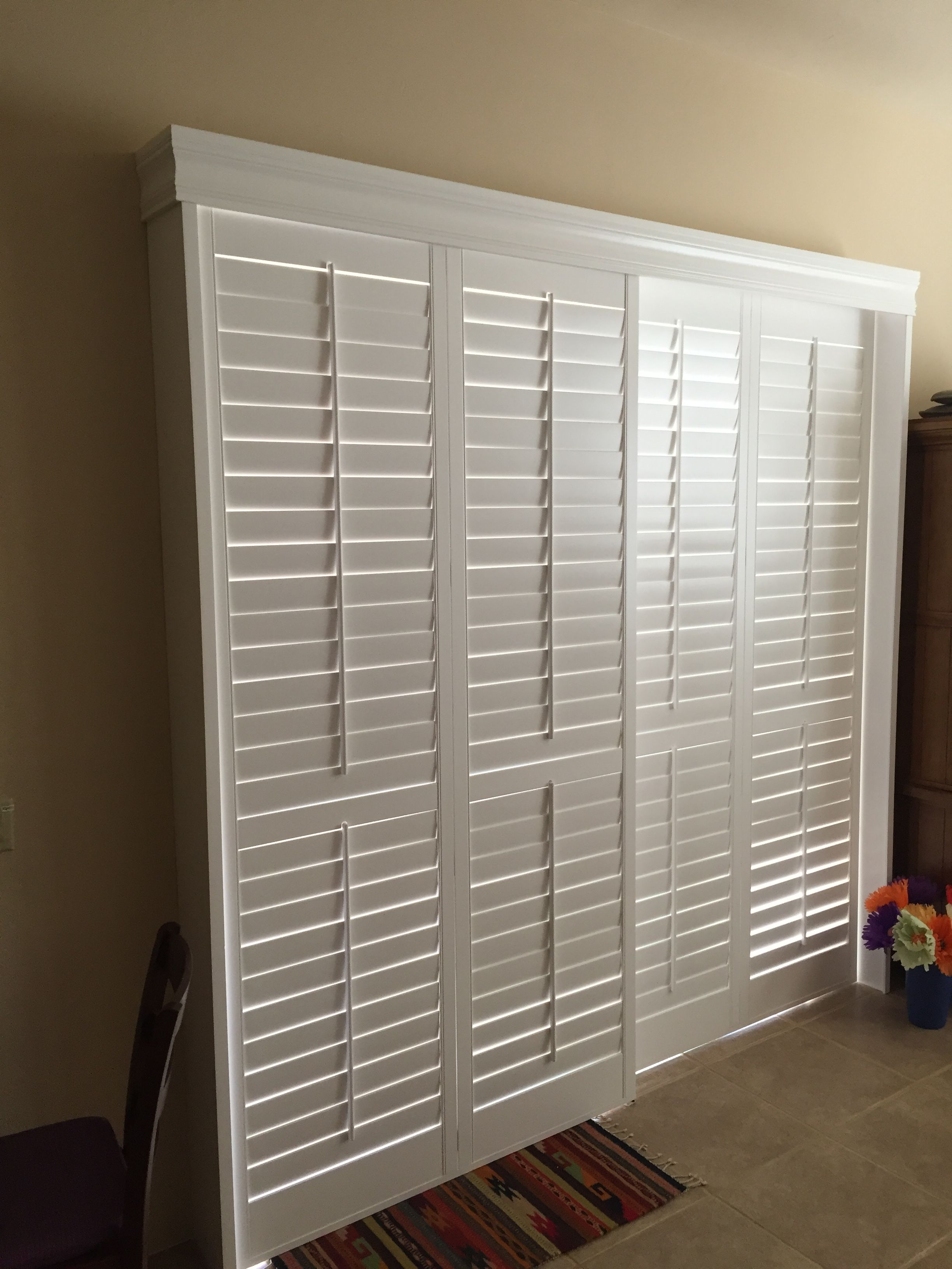 Open By Pass Shutter Over A Large Sliding Glass Door 3 12 Louvers
