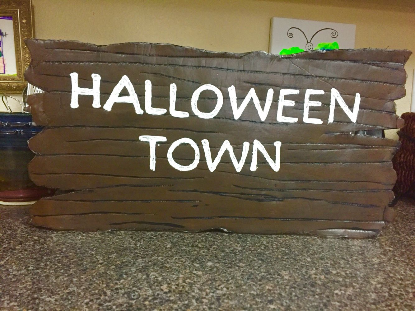nightmare before christmas decorations halloween town sign made from foam board and paint used scissors to indent sign to look like wood