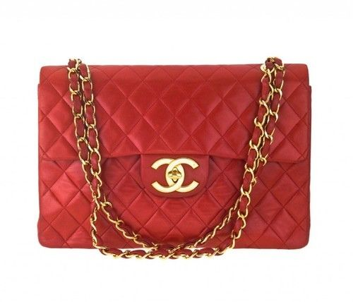 2f667b0f7e79 Small red quilted Chanel bag with gold chain straps with red strip woven  through chains - classic