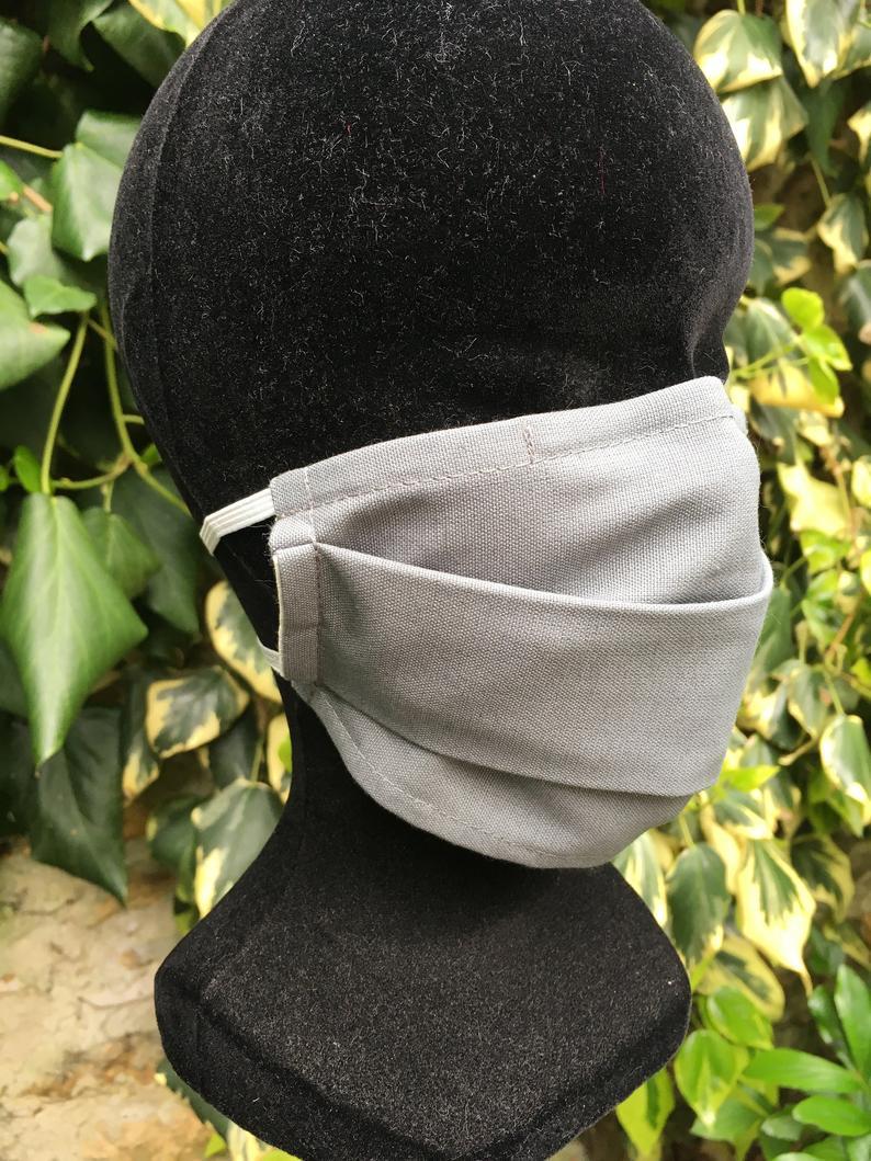 Photo of Masque facial lavable et réutilisable. Coton uni gris et Doublure en Coton Déperlant / Respirant. Avec Pince-Nez. Homme/Femme/Enfant – Masque