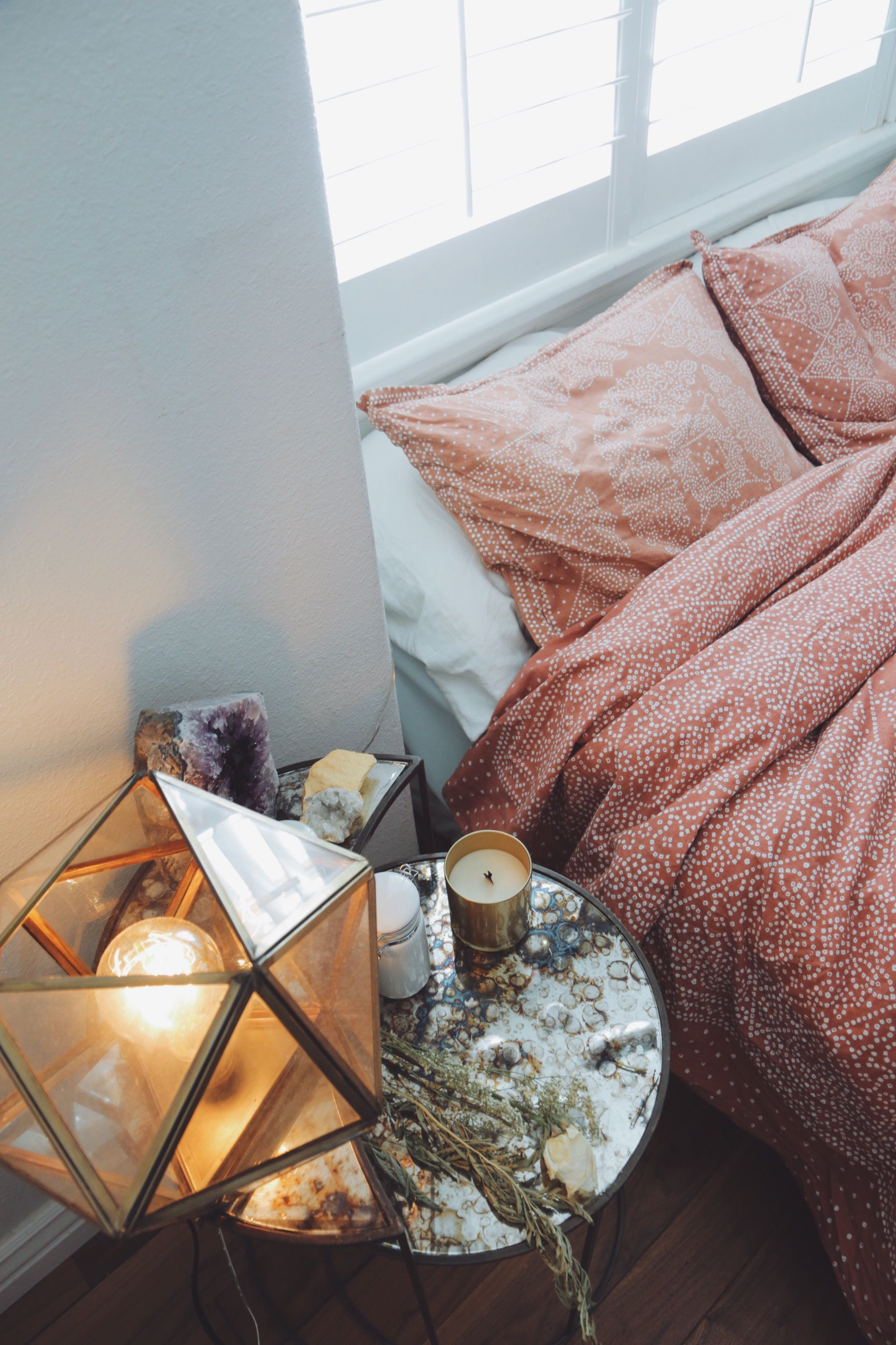 Cozy bedroom- candles, messy bed and fairy lights create a ...