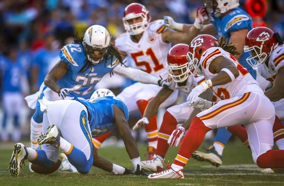 San Diego Chargers wide receiver Javontee Herndon (81) fumbled a punt return, recovered by Kansas City Chiefs cornerback Jamell Fleming (30) on Sunday, November 22, 2015 at Qualcomm Stadium in San Diego, Calif. The Chiefs won, 33-3.