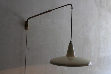Lampada parete con braccio allungabile e direzionabile manifattura
