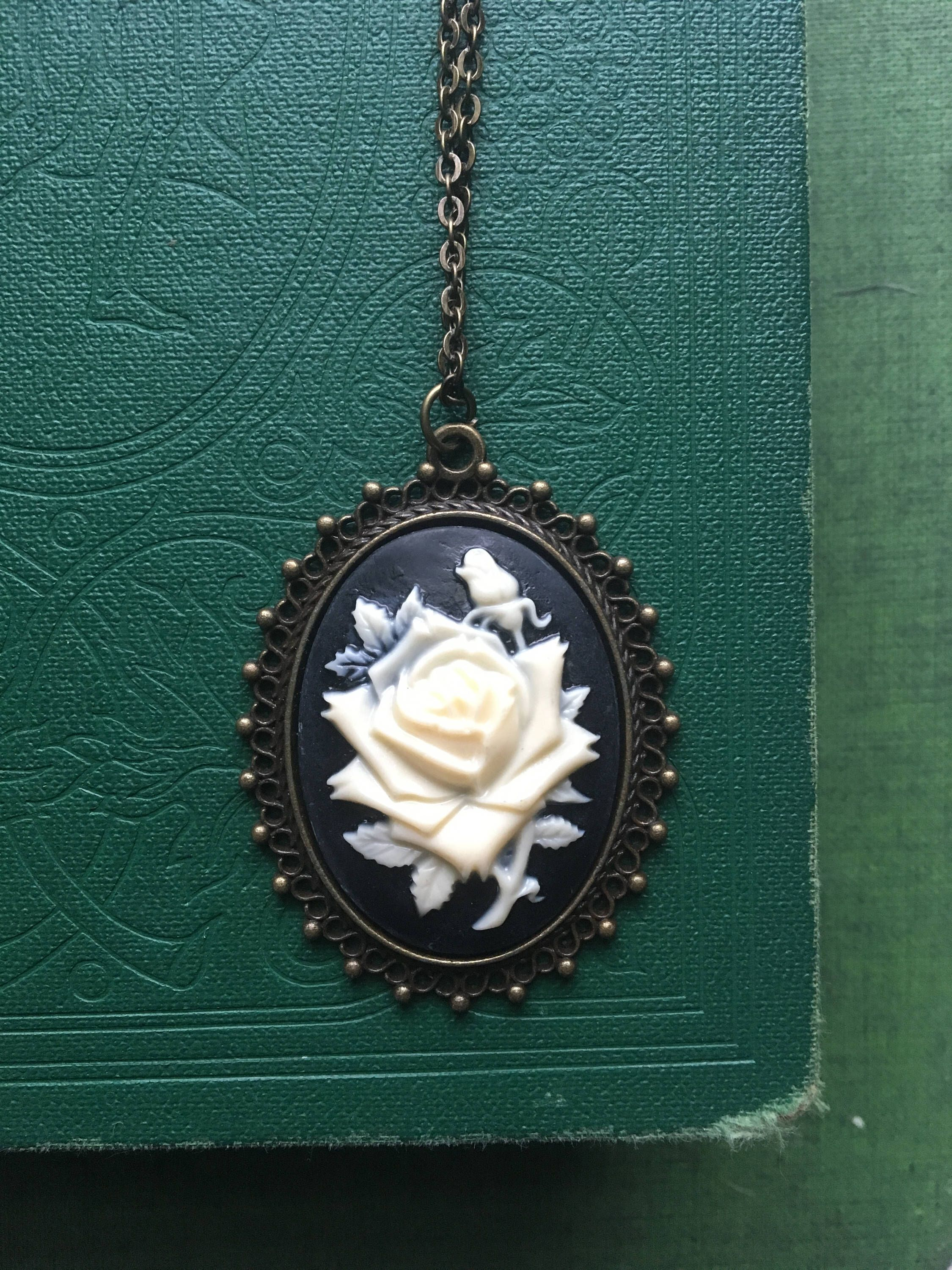 0bf78896864 Excited to share this item from my #etsy shop: White Rose Cameo Necklace,  Black and White Cameo with Brass Bronze Filigree Frame, Victorian Rose  Jewelry, ...