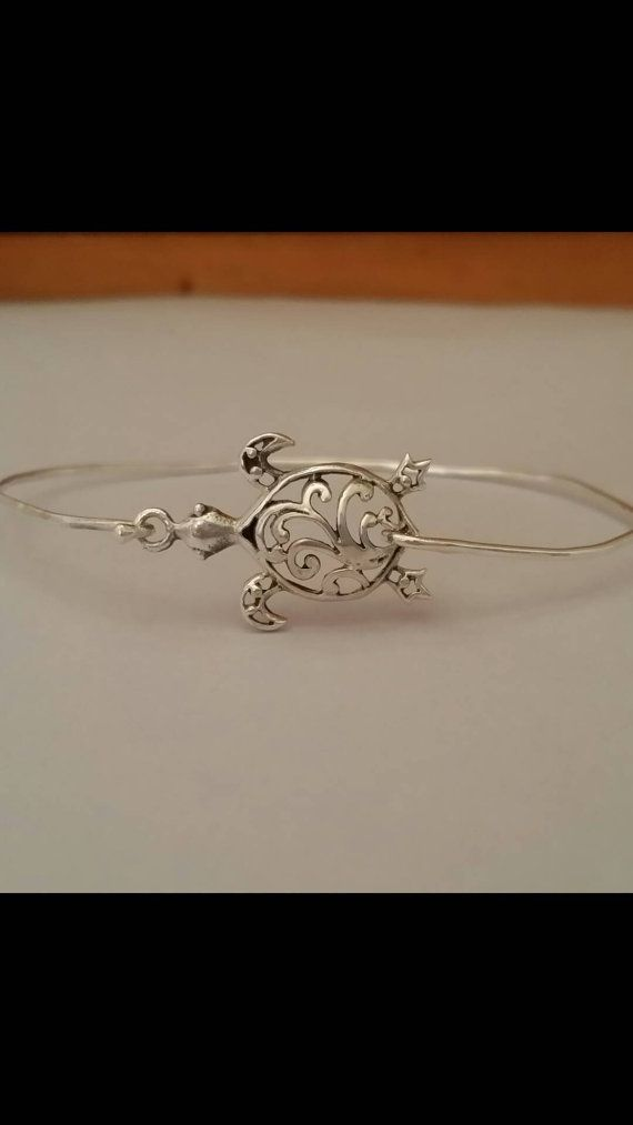 Check out this item in my Etsy shop https://www.etsy.com/listing/448912234/sterling-silver-turtle-bracelet-bangle