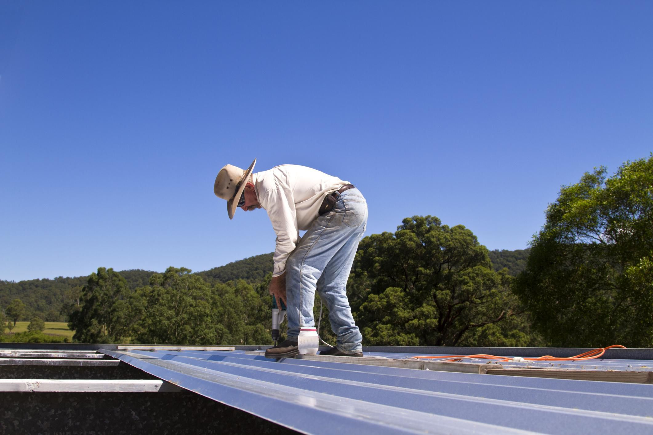 How To Easily Repair A Hole In A Metal Roof System Metal Roof Metal Roof Repair Roofing Systems