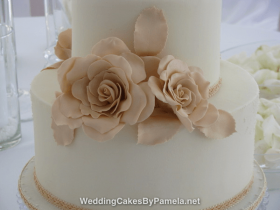 """An elegant Wedding Cake for a beautiful & intimate Wedding. Created with sharp edged royal icing & huge handmade sugar roses. The """"nude"""" shades were so soft and pretty & the braided ribbon added the finishing touch. Pamela designs and makes Wedding Cakes for destination weddings in the French Riviera, Provence, Var and Alpes Maritime. Delivering throughout the region from Monaco, Nice, Cannes, to Saint Tropez & Aix en Provence and everywhere in between."""