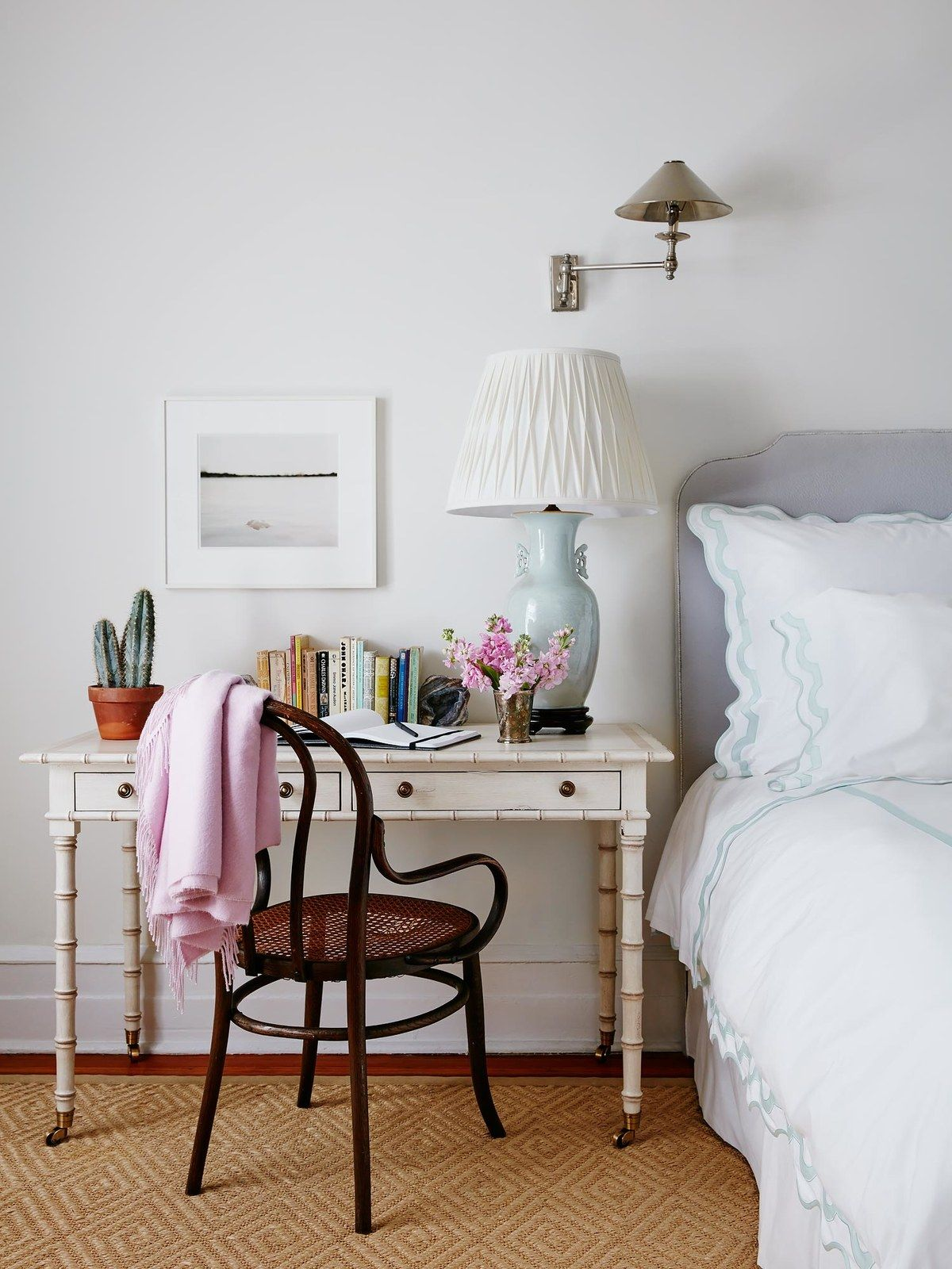 A Desk Doubles As A Bedside Table In This Small Bedroom.
