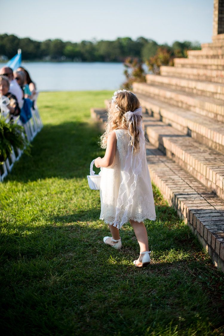 Intimate Backyard Summer Wedding On The Water Flower Walking Down Aisle