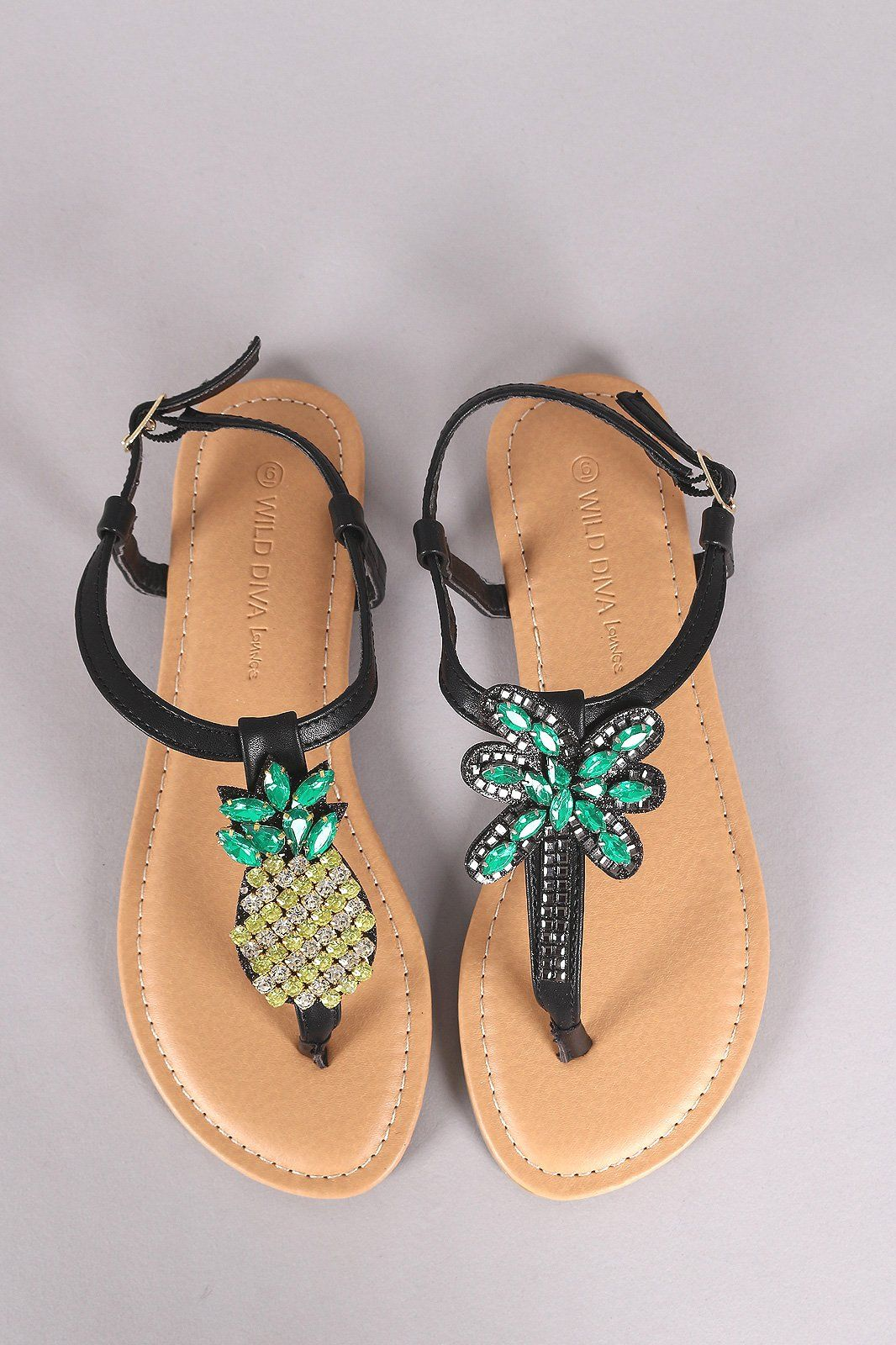 12904e6600c This flat sandal features a T-strap design with mismatched rhinestone- embellished pineapple tree