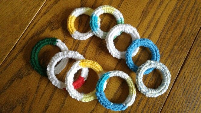 Cat toys completed 11/4/2015, for the cat shelter gift shop.  No pattern required; just do some single crochets with cotton yarn, around the ring from a plastic milk bottle.  My cats don't get excited about these toys, but apparently they are very popular at the shop.  Update 1/16/2016:  I have made quite a few more of these, averaging about a dozen a month, but I'm not going to take pictures of all of them.  5/14/2016, completed 12 more.