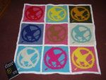 Mockingjay blanket (crochet charts can be found at http://hungergamesdwtc.net/hunger-games-crafts/crochet/)