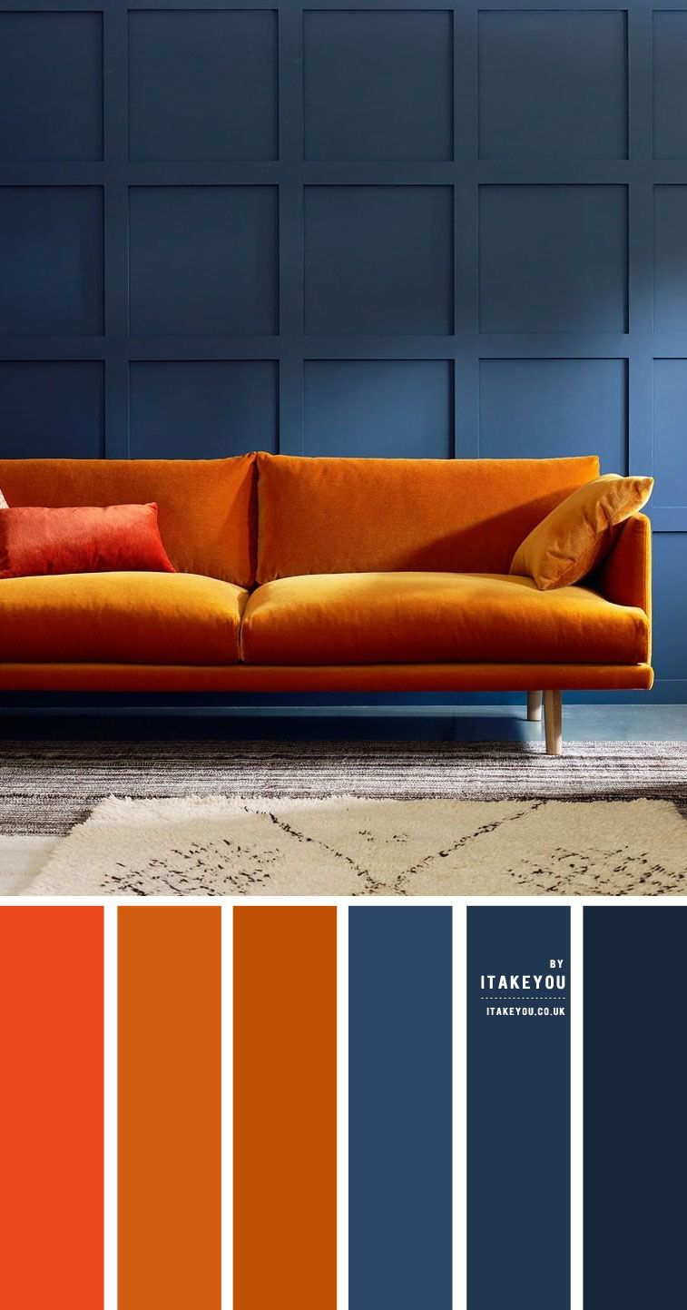 Dark blue and rust color scheme for living room