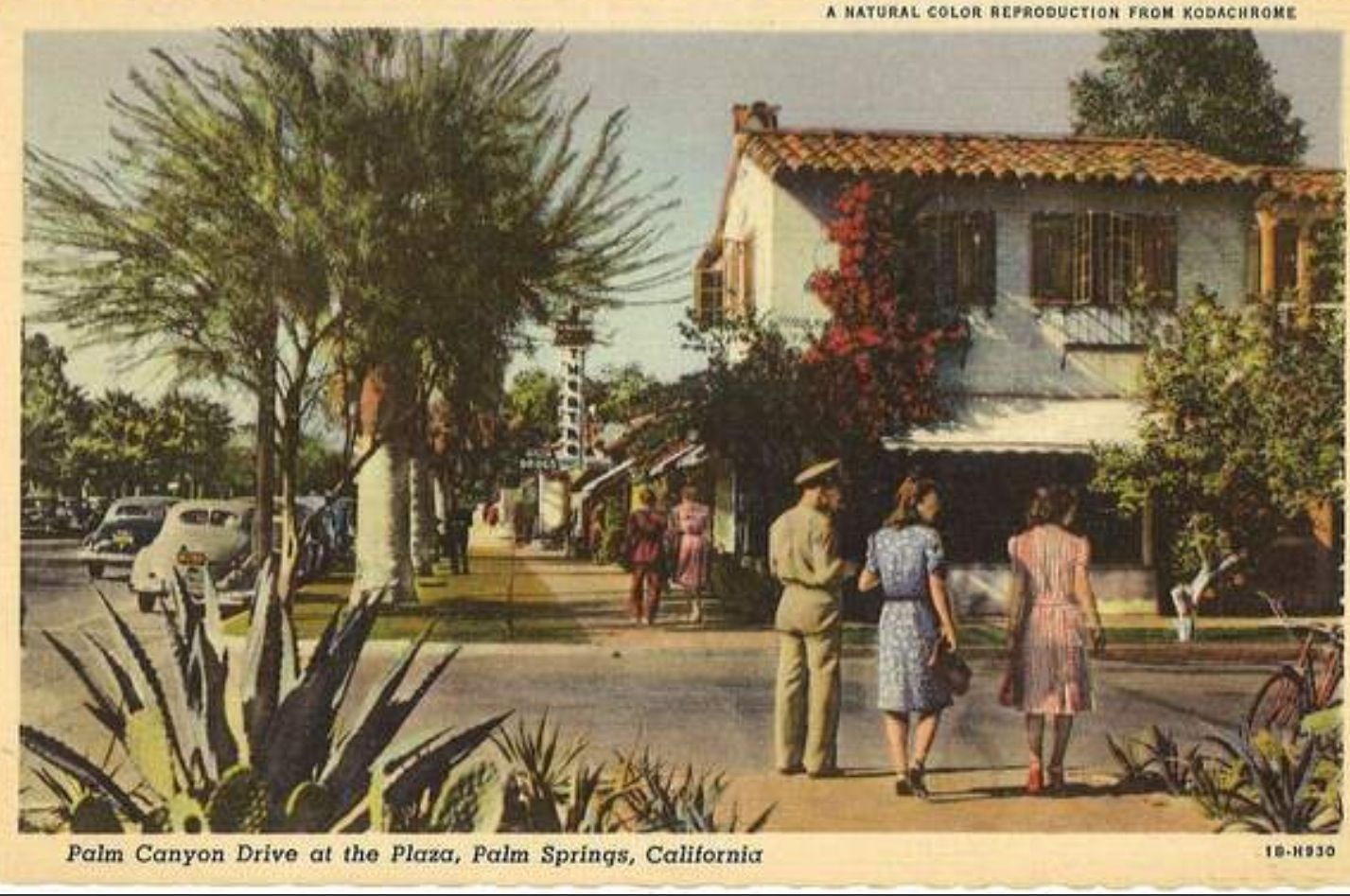Palm Canyon Drive, Candy Store: 1945, shows Palm Canyon Drive in downtown Palm Springs. The building in the foreground is now the See's Candies store, and the Plaza Theater can be seen in the background.
