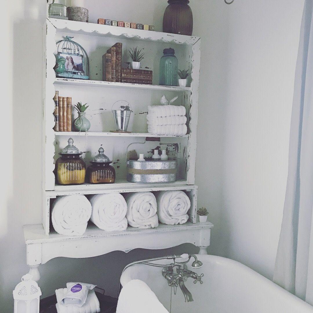 white farmhouse over the toilet storage