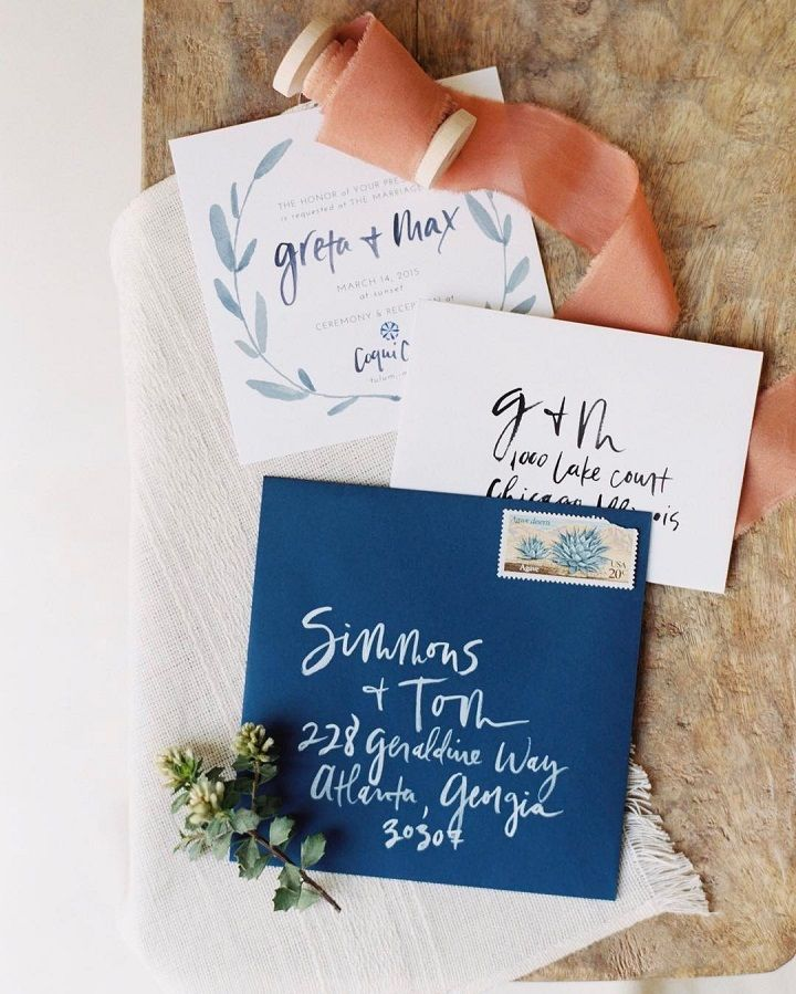 Pretty blue wedding calligraphy on wedding invitations + navy blue envelope #weddinginvites #invitations