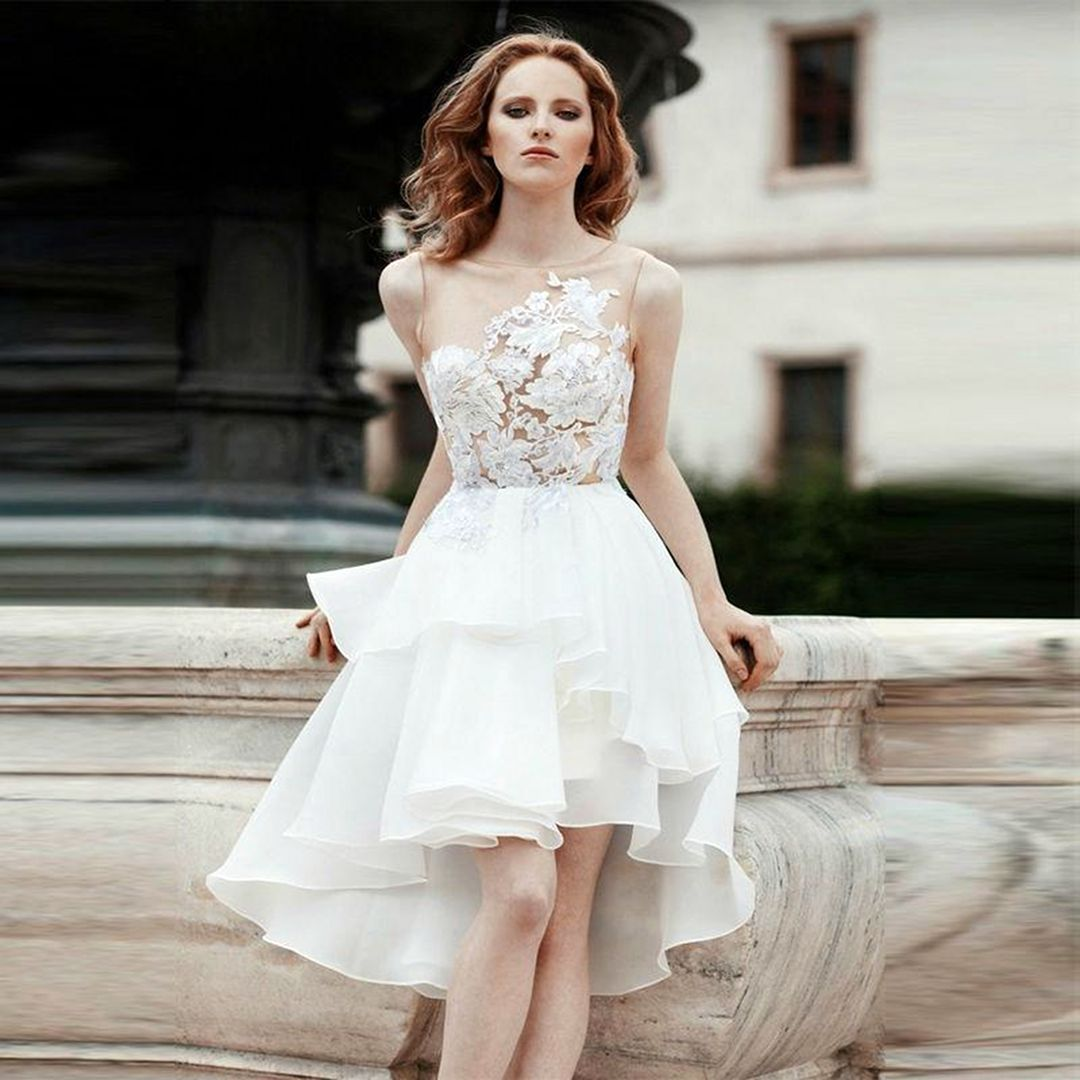 15 Elegant Short White Wedding Dresses Ideas For Your Wedding Inspiration Fashions Nowadays Sheer Wedding Dress Wedding Dresses Satin Short Wedding Dress [ 1080 x 1080 Pixel ]