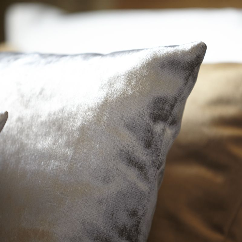 Metallics can be used in many different ways throughout your home, bringing a different look and feel to each room. We couldn't resist this simple silver cushion to feature in the bedroom.   #Strata