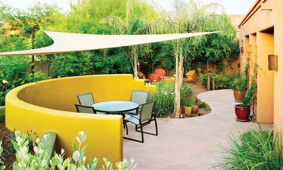 bistro patio a freeform hardscape a shade sail airy