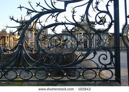 ornate wrought iron gate. ornate barbed wrought iron gate