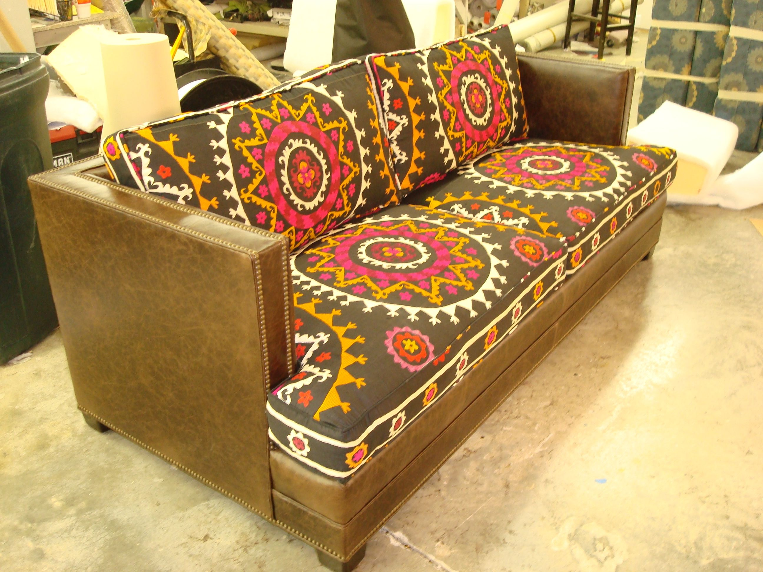 Covering Leather Sofa With Fabric Design Cushions On Sofa