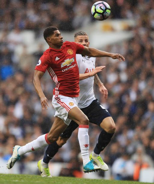 Marcus Rashford of Manchester United and Toby Alderweireld of Tottenham Hotspur battle for possession during the Premier League match between...