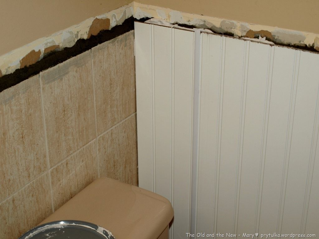 Good Bye Old Tile Covering With Wainscotting Bathroom Wall Tile Bathroom Tile Diy Bathroom Wall Panels