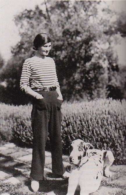 Coco Chanel at Villa La Pausa in Roquebrune, French Riviera, with her dog, Gigot, 1930.