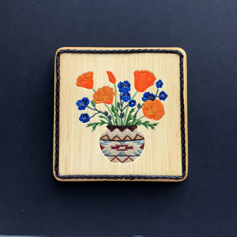 Southwestern wildflowers in navajostyle vase balsa wood embroidery