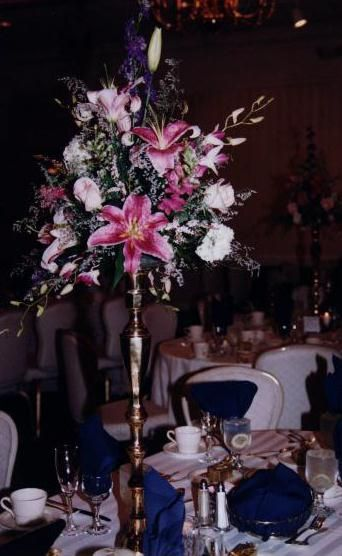 Brass Stand with lilies, roses, larkspur and dendrobiums make a great statement.