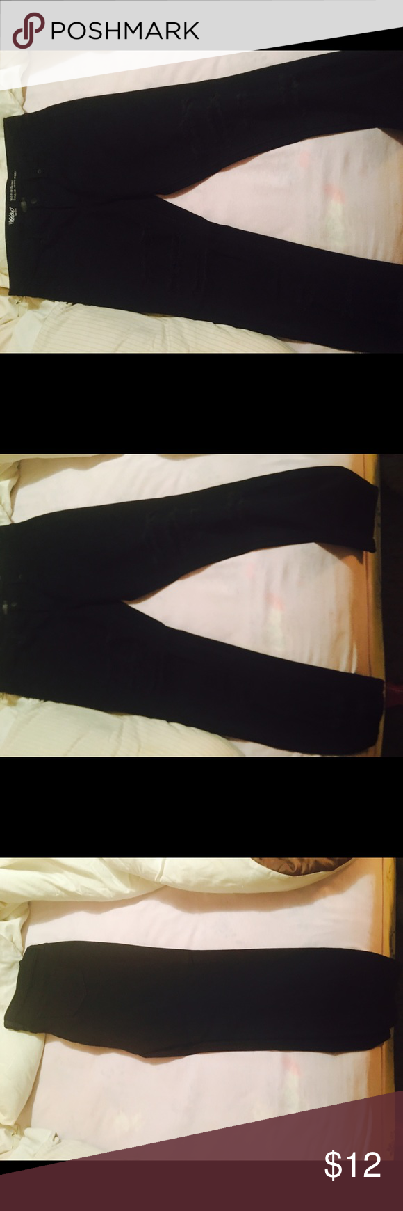 Black denim with rips in the leg too small Black denim jeans with rips cute comfortable i have three pair wore once Mossimo Supply Co Jeans Skinny