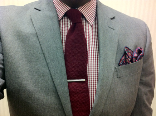 Grey Kenneth Cole suit, red plaid shirt, red knit tie, blue and ...