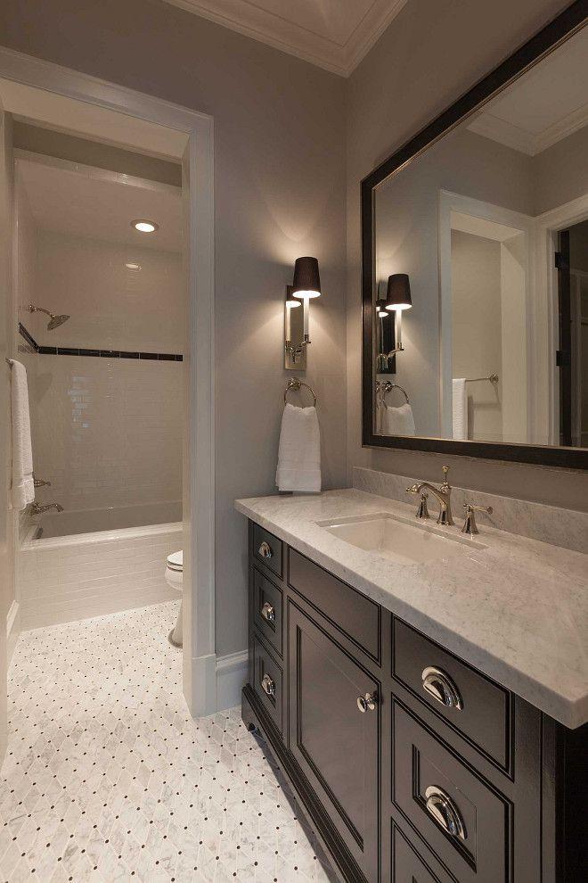 Trending geometric floor tile with dark cabinetry and beige walls